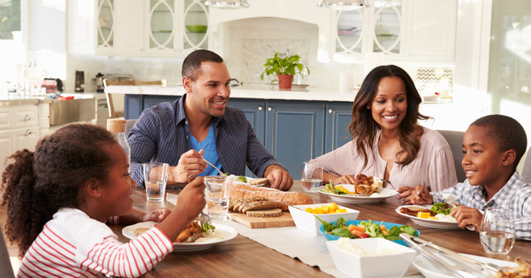 family at dinner table - ways to nurture gratitude