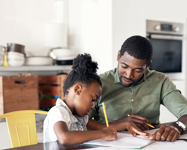 parent and child doing schoolwork