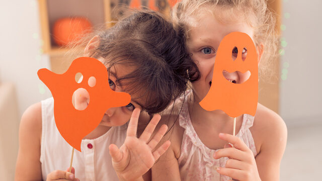 kids celebrating halloween in class