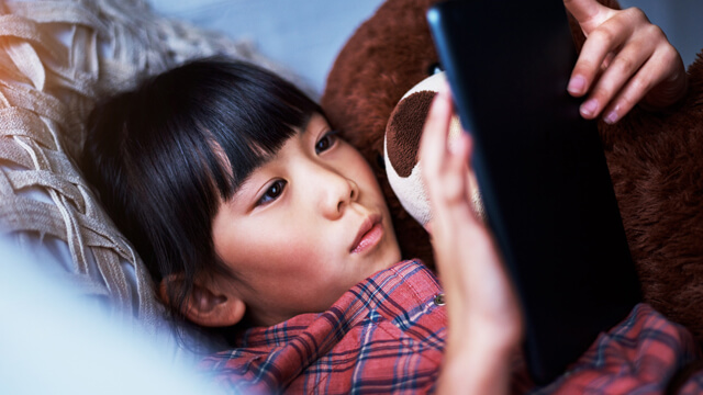 child with device
