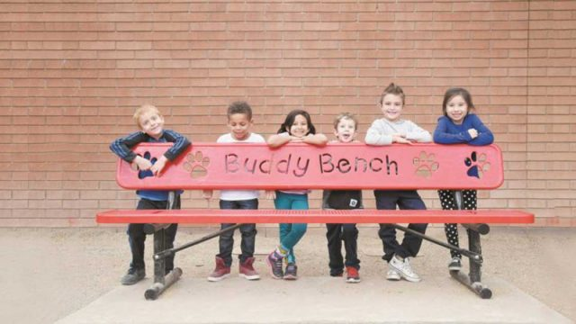 students with buddy bench