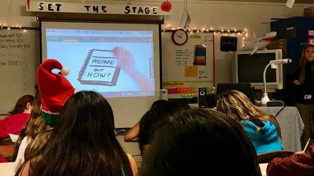 teacher at front of class