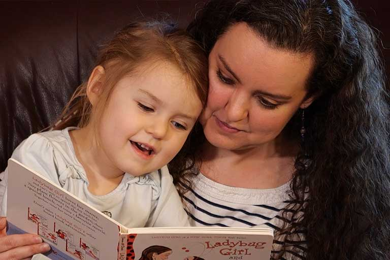 mother reading with child, child abuse prevention